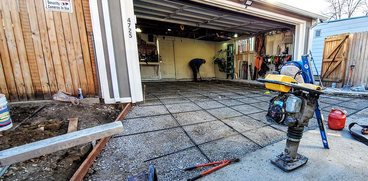 Colorado concrete contractors working on a garage floor replacement in Northside of Denver